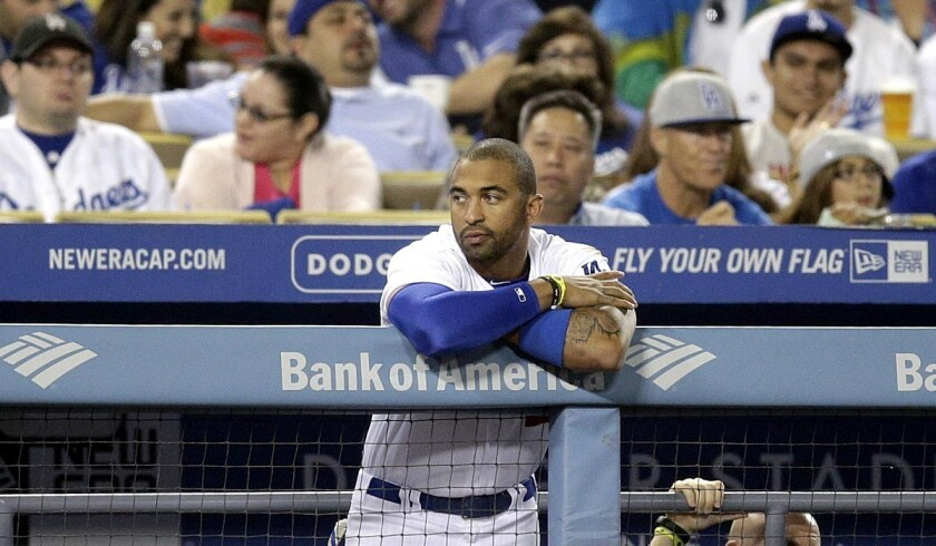Dodgers outfielder Matt Kemp watches from the dugout during the seventh inning of a game against the Pittsburgh Pirates last week.