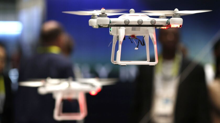 Drones fly at the CES electronics show in Las Vegas in 2015. (John Locher / Associated Press)