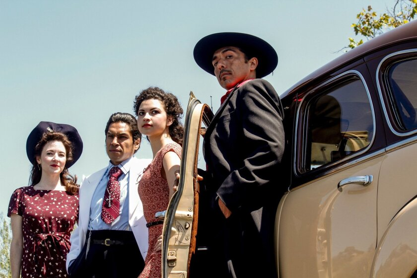 """Jo Anne Glover, Lakin Valdez, Maya Malan-Gonzalez and Raul Cardona (left to right) in San Diego Rep's """"Zoot Suit."""""""