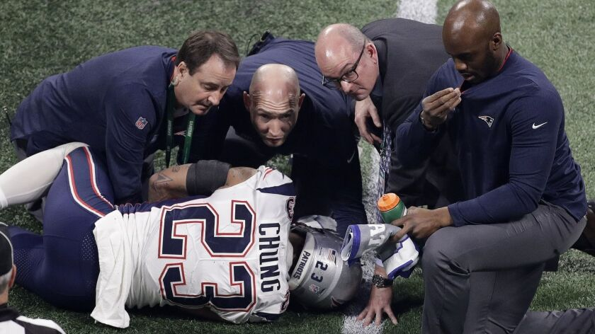 New England Patriots' Patrick Chung (23) is helped by medical staff after an injury during the secon