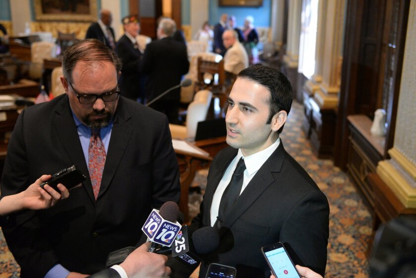 State Senator Jim Ananich, D-Flint, left, listens as Amir Hekmati speaks to the media in the Michigan Senate Chamber on Thursday, May 26, 2016, in Lansing, Mich. Hekmati is a former United States Marine who was detained in August 2011 in Iran on espionage charges. (Julia Nagy/Lansing State Journal