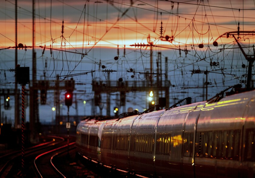 A train leaves the main train station after the sun set in Frankfurt, Germany, Friday, Jan. 17, 2020. (AP Photo/Michael Probst)