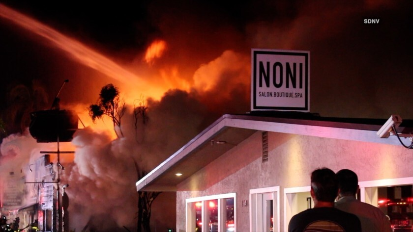 Firefighters extinguished a two-alarm fire at Mozy Cafe in Encinitas early Monday morning.