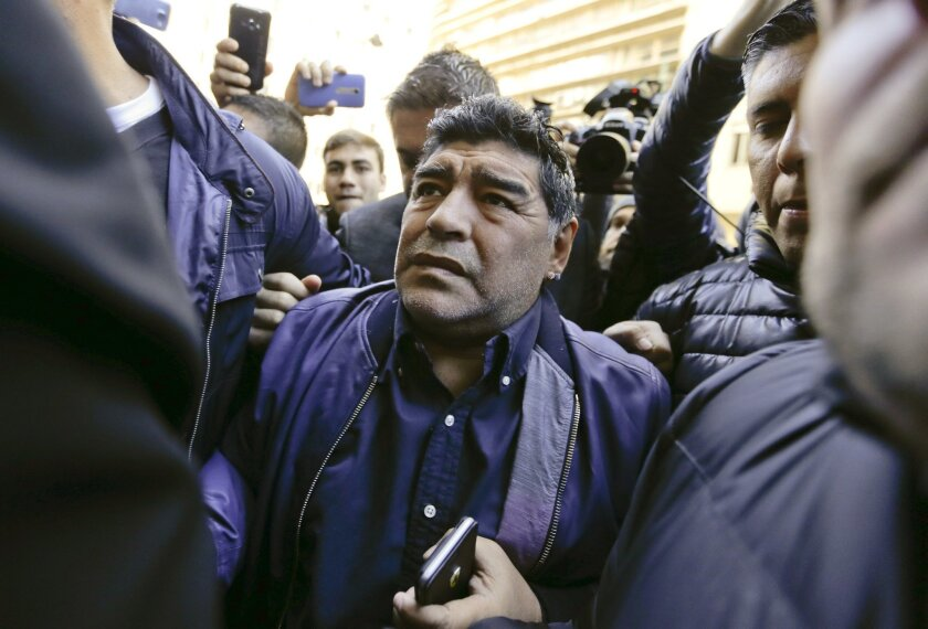 FILE - In this July 6, 2016 file photo, soccer legend Diego Maradona arrives to the Argentine Football Association (AFA) in Buenos Aires, Argentina, which the FIFA intervened in the midst of the institutional crisis in the South American organization. Maradona offered to lead Argentina's selection