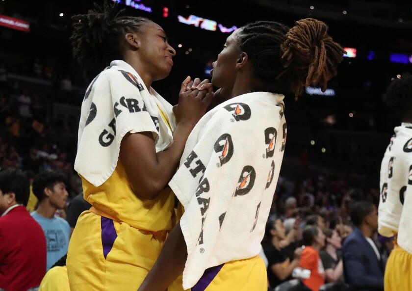 Sparks forward Nneka Ogwumike, left, and guard Chelsea Gray (12) celebrate after a win last season.