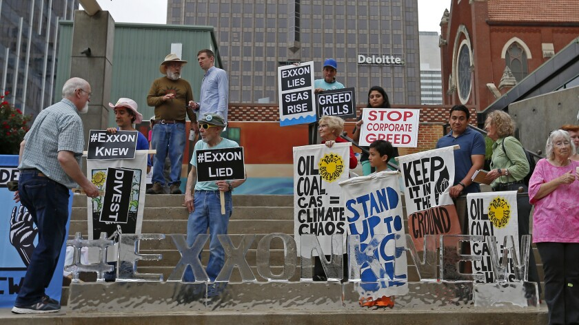 Protesters outside the Exxon Mobil annual shareholder meeting