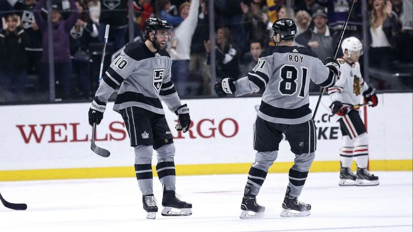 Los Angeles Kings forward Michael Amadio (10) celebrates his goal with Matt Roy (81) during the thir