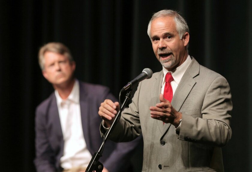 FILE - In this June 27, 2016, file photo, U.S. Rep. Tim Huelskamp, R-Kan., answers a question during a debate in Hutchinson, Kan., with his Republican primary challenger Dr. Roger Marshall, left, in Kansas' 1st Congressional District. (Travis Morisse/The Hutchinson News via AP, File)