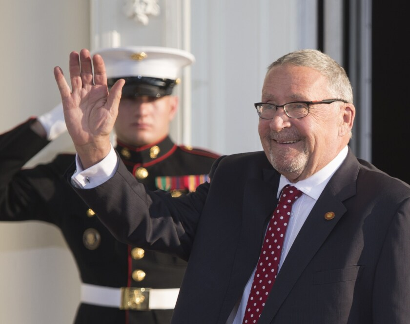 Guy Scott arrives Aug. 5 at the White House for a group dinner during the U.S. Africa Leaders Summit. Then Zambia's vice president, he became acting president Wednesday after the death of President Michael Sata.