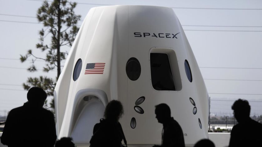 A mock-up of the Crew Dragon spacecraft was on display for members of the media at SpaceX in Hawthorne on Aug. 13.