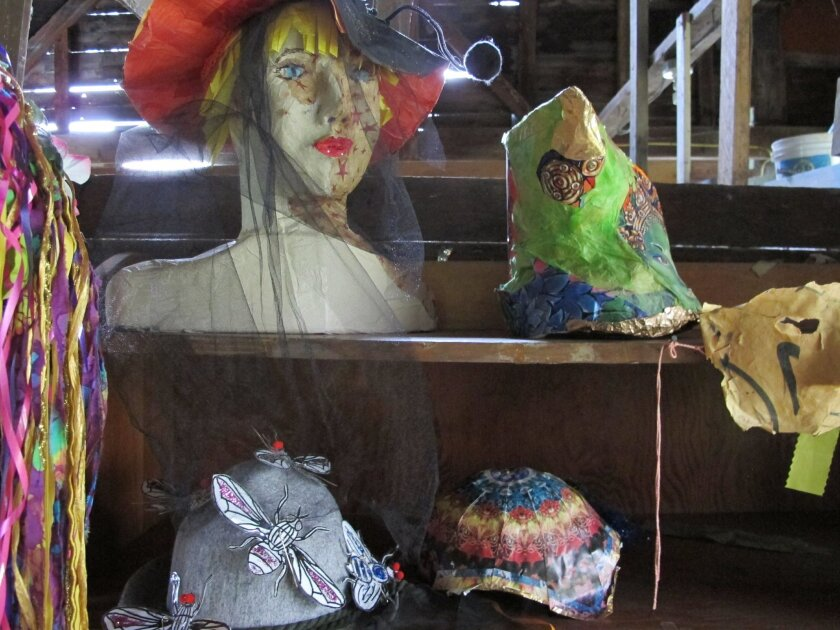 A collection of bug-related hats, some with insect netting, in advance of the annual Blackfly festival, giving tribute to the spring outdoor nuisance, are displayed in Adamant, Vt., Thursday June 2, 2016. The festival includes a combination parade and fashion show, with music and a blackfly pie con