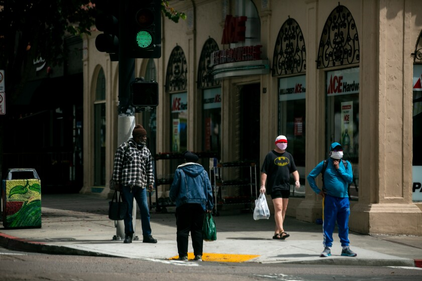 Masks, social distancing and good judgment will be required when the economy is slowly reopened. A street scene in Hillcrest on April 13.