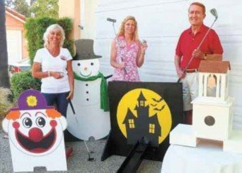 Among those organizing the new miniature golf game during the Spirit of the Fourth community fair are Rancho Bernardo Business Association members, from left, Kim Wetzel, Debbie Kurth and RBBA President Marty Judge.