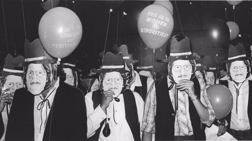 (L-R) - Demonstrators wearing masks of Maurice Tuchman, the County Art Museum curator, on July 15, 1