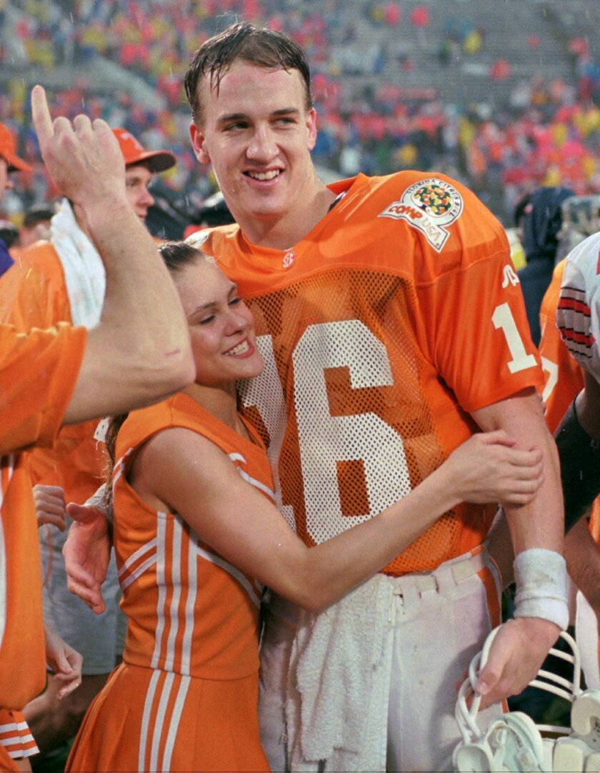 FILE - In this Jan. 1, 1996, file photo, Tennessee quarterback Peyton Manning (16) is congratulated by an unidentified cheerleader after Tennessee defeated Ohio State 20-14 to win the Citrus Bowl, in Orlando. The lawyer for six women suing the University of Tennessee on its handling of sexual assau