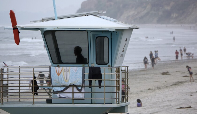 A state lifeguard looks over Torrey Pines State Beach on Monday.
