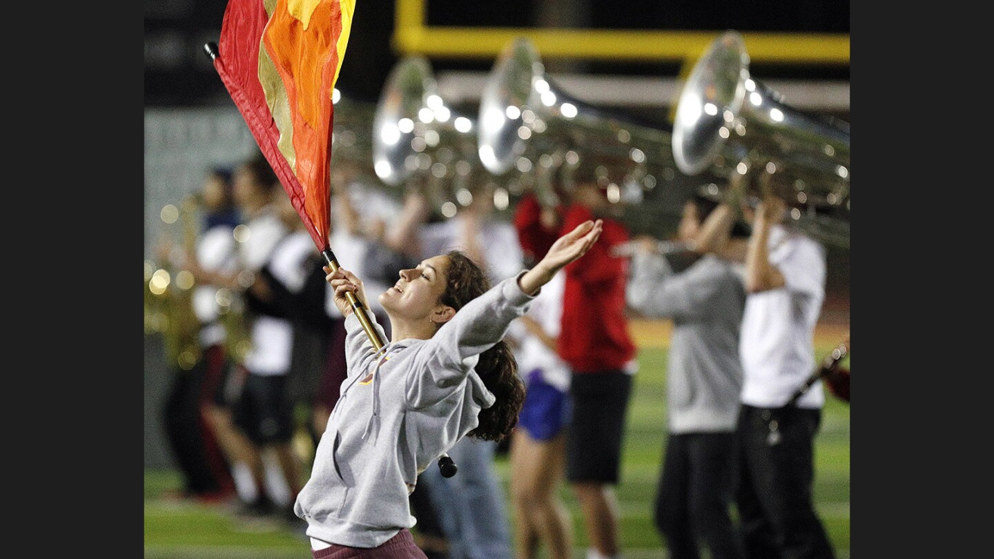 """Maddy Mertens, 17, of the La Canada High School Marching Band and Color Guard at a last-week rehearsal of their field show """"Rapunzel"""" on Tuesday, November 14, 2017. The band will perform a friends and family show this Friday before traveling to Fresno for the Western Band Assn.'s Class Championships this Saturday."""