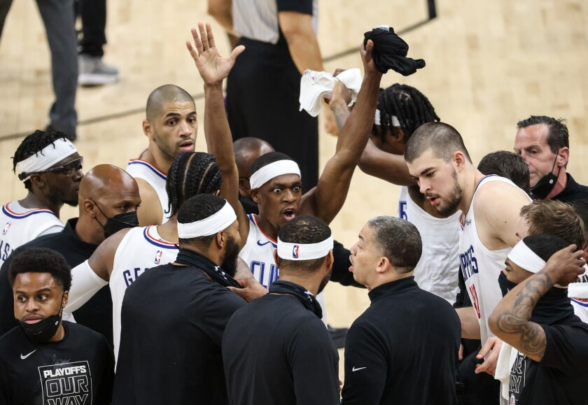 Clippers guard Rajon Rondo vehemently reminds his teammates to raise their hands on defense.