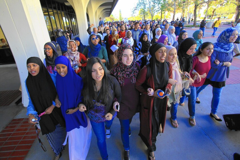 SDSU students and others march in protest of acts of hatred and intolerance against Muslims and other groups.