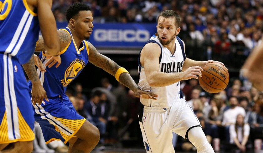 Dallas Mavericks guard J.J. Barea (5) drives around Golden State Warriors forward Brandon Rush (4) during the second half on Wednesday.