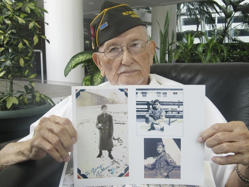 "In this May 3, 2016, photo, Arthur Ishimoto, 93, a Japanese-American and U.S. Army Military Intelligence Service veteran, poses with archival photographs of himself as he is interviewed in Honolulu. Two very different visions of the hell that is war are seared into the minds of World War II survivors on opposite sides of the Pacific. Collectively, they help explain the differing reactions to President Barack Obama's decision to become the first sitting American president to visit the memorial to atomic bomb victims in Hiroshima later this week. Ishimoto said it's good for Obama to visit Hiroshima to ""bury the hatchet"", but there's nothing to apologize for. (AP Photo/Audrey McAvoy)"