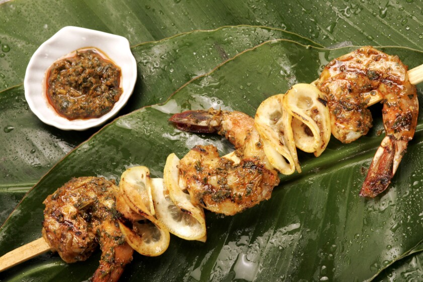 Grilled shrimp skewers and charmoula
