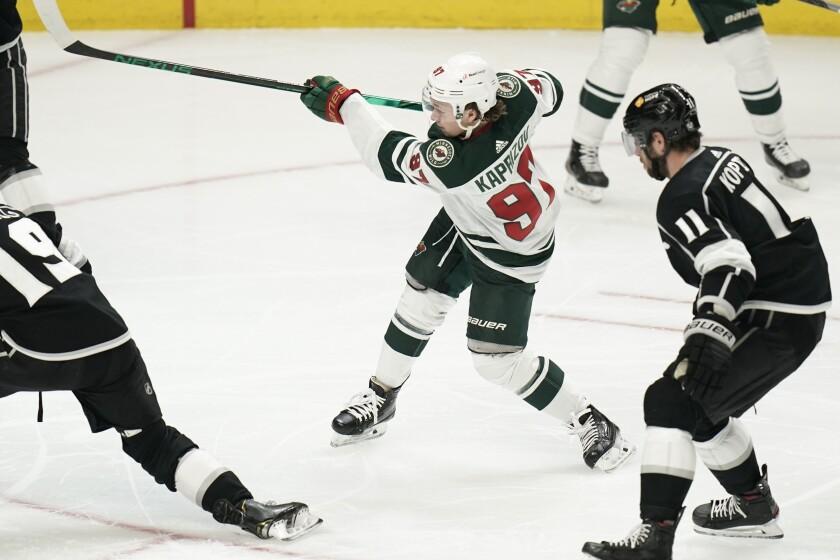 Minnesota's Kirill Kaprizov shoots to score his second goal against the Kings on Friday.