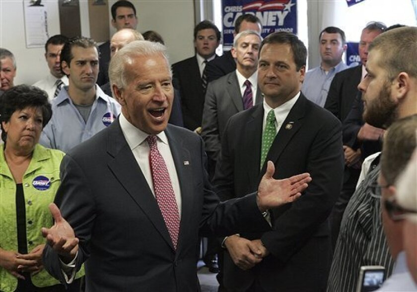 Vice President Joe Biden, left center, and U.S. Rep. Chris Carney, right center, visit volunteers and supporters at the congressman's campaign office in Dickson City, Pa. on Monday, Oct. 11, 2010. (AP Photo/Scranton Times & Tribune, Michael J. Mullen) WILKES BARRE TIMES-LEADER OUT; MANDATORY CREDIT