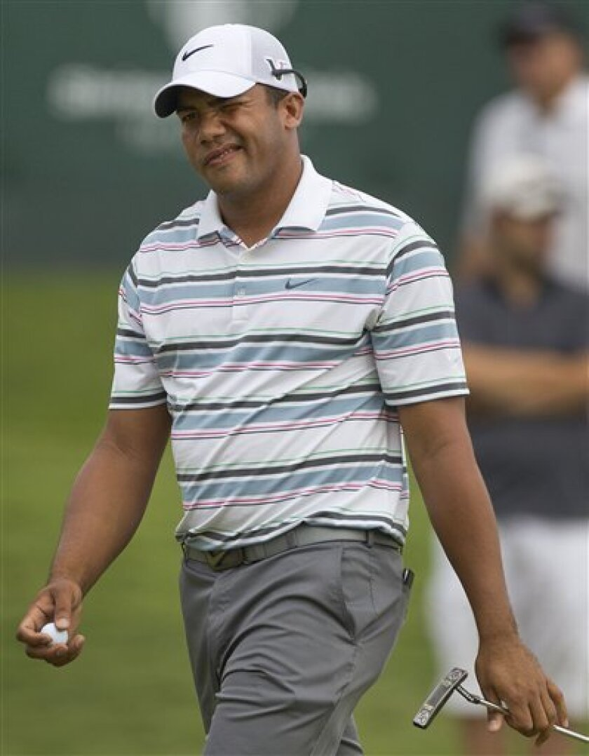 Jhonattan Vegas, of Venezuela, reacts after sinking a putt on the 18th green during the second round of the Justin Timberlake Shriners for Hospitals for Children Open golf tournament, Friday, Sept. 30, 2011, in Las Vegas. (AP Photo/Julie Jacobson)