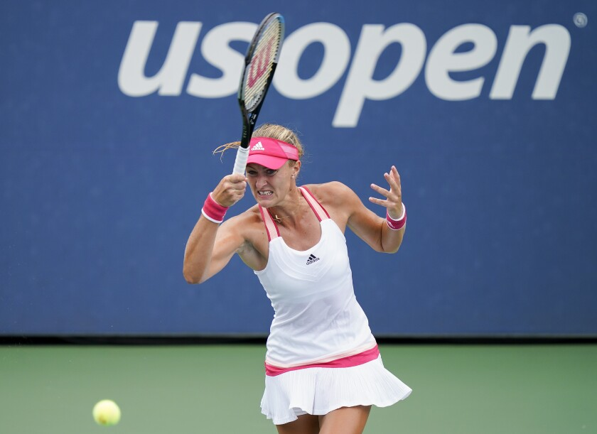 Kristina Mladenovic, of France, returns a shot to Varvara Gracheva, of Russia, during the second round of the US Open tennis championships, Wednesday, Sept. 2, 2020, in New York. (AP Photo/Seth Wenig)