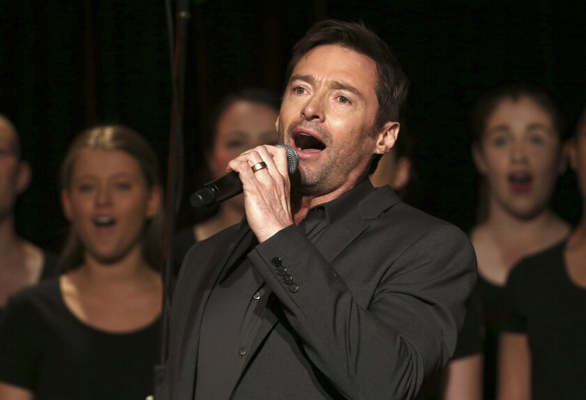 """Actor Hugh Jackman sings on stage before holding a press conference where he announced his new stage show """"Broadway to OZ"""" in Sydney, Australia, Monday, Aug. 24, 2015. Jackman is returning to Australia for a five-city arena concert tour in November and December, 2015 based on his Broadway show, """"Hugh Jackman: Back on Broadway."""" (AP Photo/Rob Griffith)"""