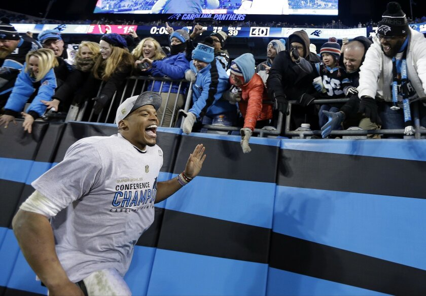 Carolina Panthers' Cam Newton celebrates with fans after the NFL football NFC Championship game against the Arizona Cardinals, Sunday, Jan. 24, 2016, in Charlotte, N.C. The Panthers won 49-15 to advance to the Super Bowl. (AP Photo/David J. Phillip)