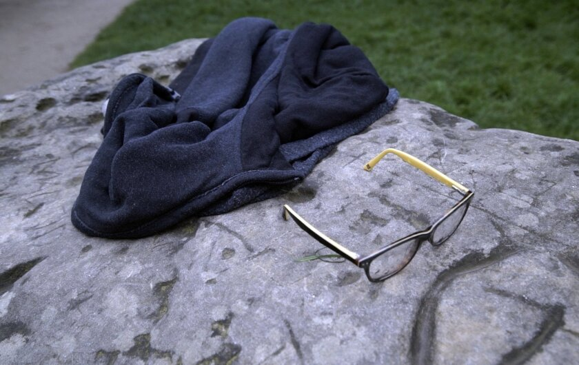 A child's glasses and a jacket lie on a rock in the Park Monceau, after a lightning strike in Paris, Saturday, May 28, 2016. A Paris fire service spokesman says 11 people including eight children have been hit by lightning in a Paris park after a sudden spring storm overtook a child's birthday part