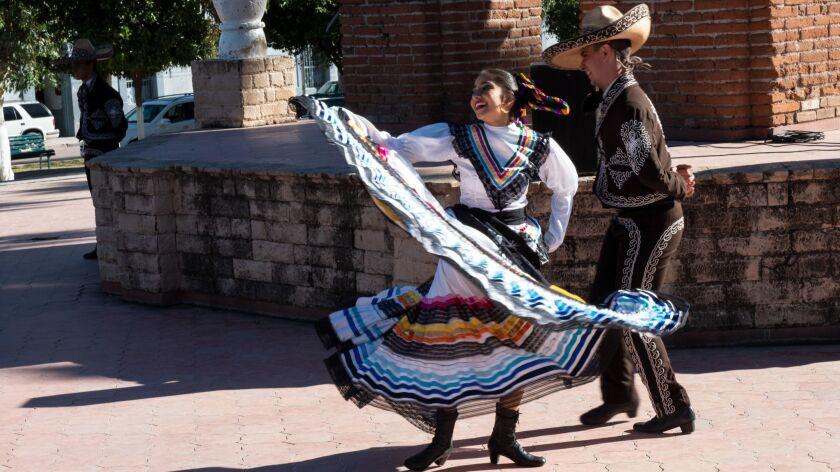 Grecia Ramos, left, and Luis Carlos Samaniego, both from Grupo de Danza Xunutzi of Ban?michi, Mexic