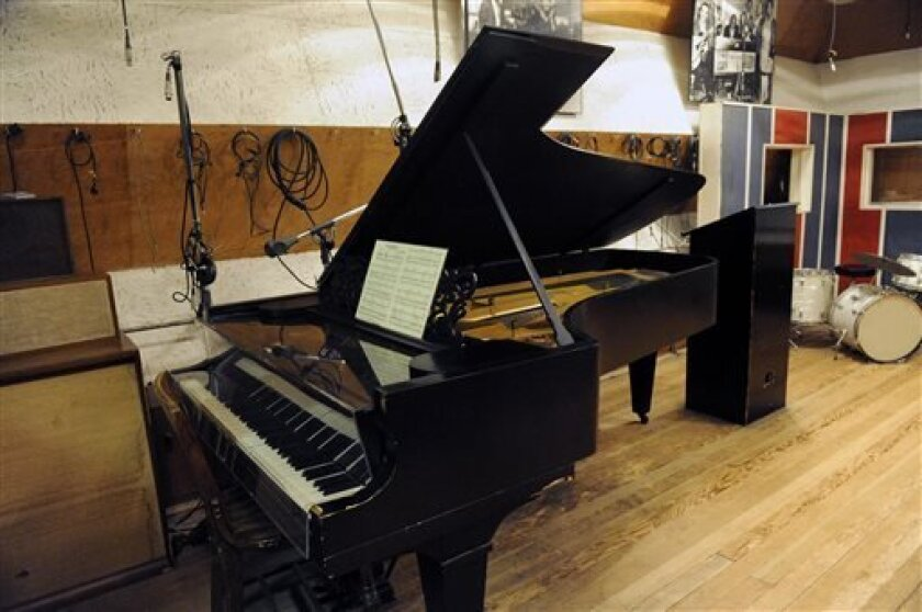 In this Oct. 31, 2011 file photo, an 1877 Steinway grand piano used by Motown artists is seen in a Motown recording studio in Detroit. Steinway Musical Instruments Inc. says an investment firm has offered to pay about $477 million for the piano maker, topping an earlier bid from Kohlberg & Co. The prospect of a bidding war sent Steinway shares up 8 percent to $39.10 in premarket trading Monday, Aug. 12, 2013. (AP Photo/Detroit News, David Coates) DETROIT FREE PRESS OUT; HUFFINGTON POST OUT ; M