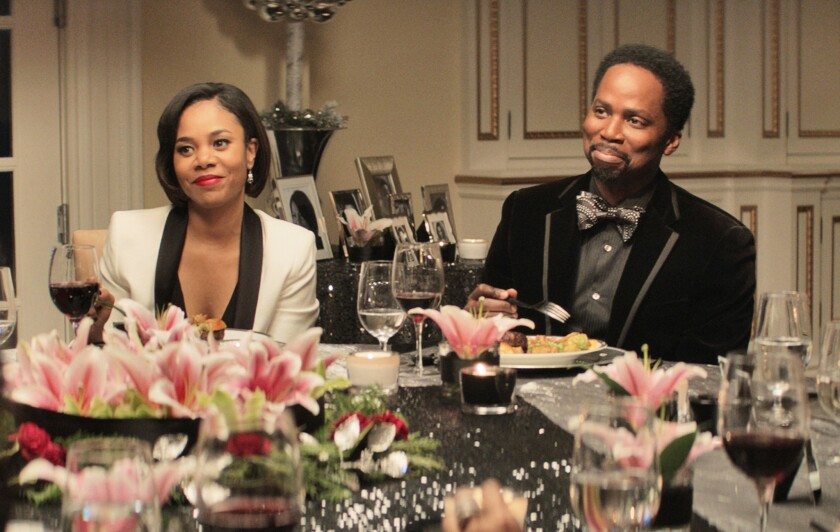 "Regina Hall and Harold Perrineau in ""The Best Man Holiday."""