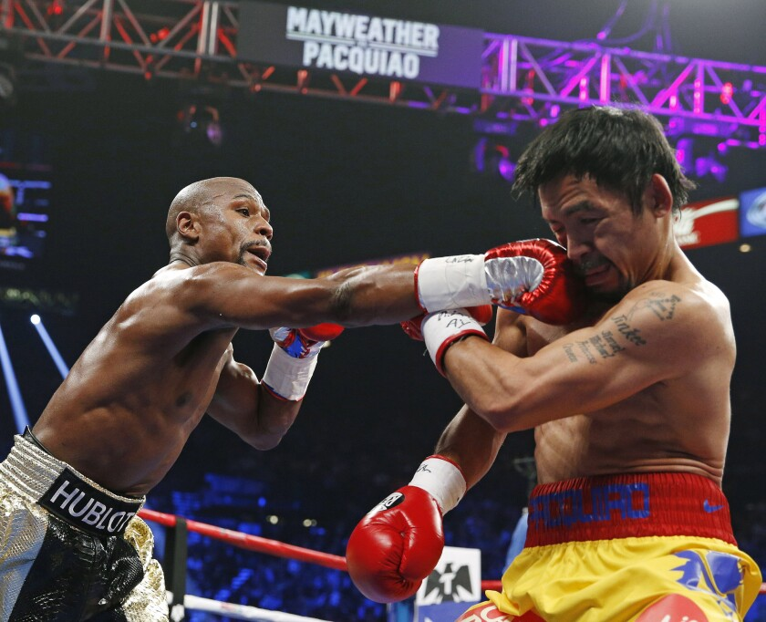 Floyd Mayweather Jr. connects with a right to the head of Manny Pacquiao during their welterweight title fight on May 2, 2015 in Las Vegas. A rematch between the now-retired Mayweather and a revitalized Pacquiao might be the crowd pleaser fight fans hoped for the first time.