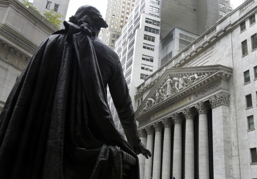 In this Oct. 2, 2014 photo, the statue of George Washington on the steps of Federal Hall faces the facade of the New York Stock Exchange, in New York. U.S. stocks opened higher Monday, Oct. 6, 2014, as investors assessed corporate news. (AP Photo/Richard Drew)