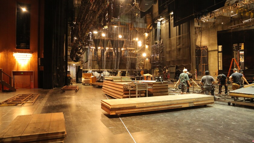 L.A. Opera's stage crew members build a new set with wood pieces