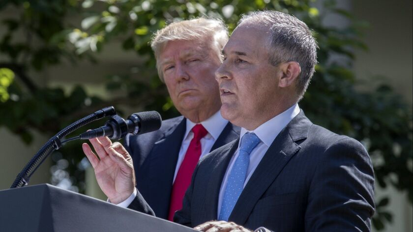 Donald Trump listens as EPA Administrator Scott Pruitt delivers remarks at the White House on June 1, 2017.