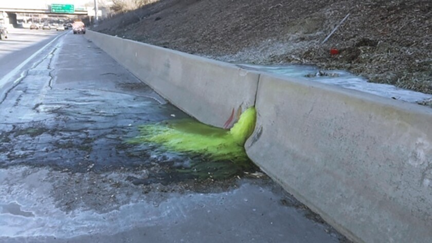 FILE - This Dec. 20, 2019 file photo provided by Michigan Department of Transportation shows toxic chemical substances leaking along Interstate 696 in Madison Heights, Mich. An industrial site in suburban Detroit where a bright green goo seeped through a concrete barrier onto an area freeway is subject to forfeiture due to non-payment of property taxes. Five properties tied to Electro-Plating Services Inc. in Madison Heights owe a total of more than $30,000 in taxes, interest and fees from 2017 and 2018, according to the Oakland County Treasurer's office.(Michigan Department of Transportation via AP, File)