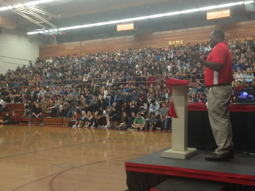 Cathedral Catholic High School basketball coach Will Cunningham speaking at Torrey Pines High School during a recent Red Ribbon Week event.