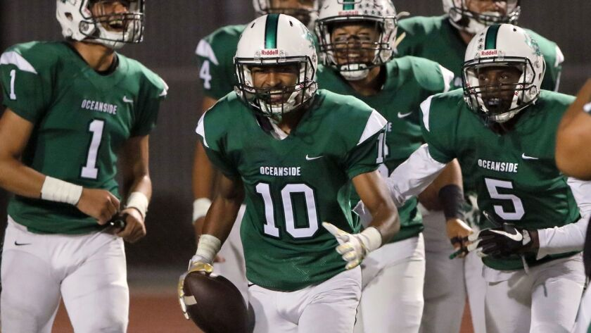 Oceanside cornerback Trejan Apodaca (10, shown in an earlier game) returned an interception for a TD to boost the Pirates.