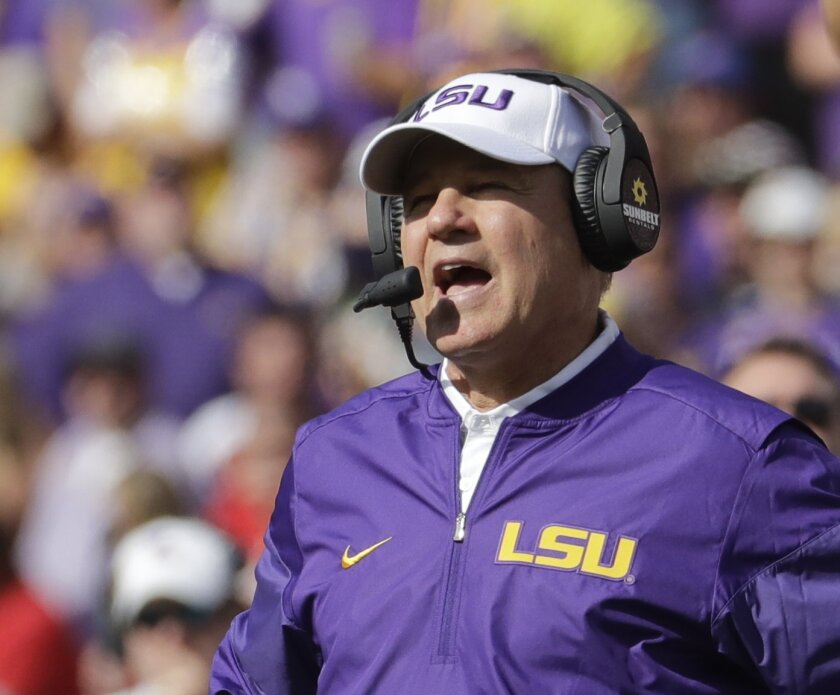 LSU head coach Les Miles watches during the first half of an NCAA college football game against Wisconsin Saturday, Sept. 3, 2016, in Green Bay, Wis. (AP Photo/Morry Gash)