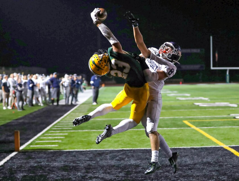 Edison's Nico Brown (23) makes an acrobatic catch for a touchdown.