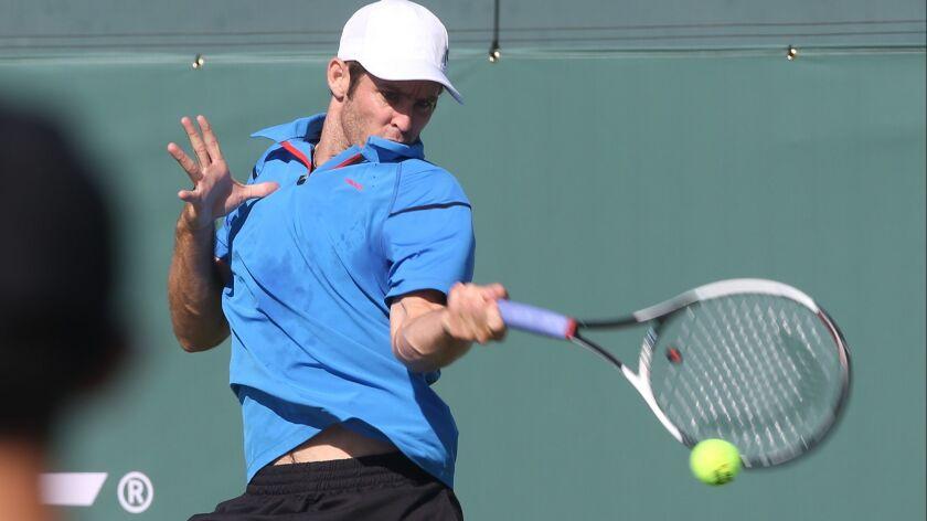 Bradley Klahn runs down a forehand during the Oracle Challenger Series at the Newport Beach Tennis C