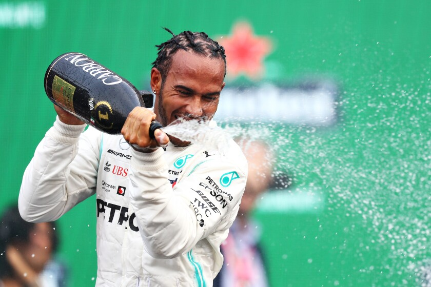Mercedes driver Lewis Hamilton celebrates after winning the Formula One Grand Prix of Mexico on Sunday.