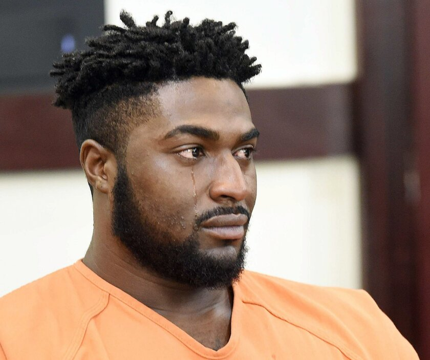 Cory Batey weeps during his sentencing hearing Friday, July 15, 2016, in Nashville, Tenn. Batey, a former Vanderbilt University football player, was sentenced to 15 years for raping an unconscious woman with his some of his teammates in 2013. (Samuel M. Simpkins/The Tennessean via AP, Pool)