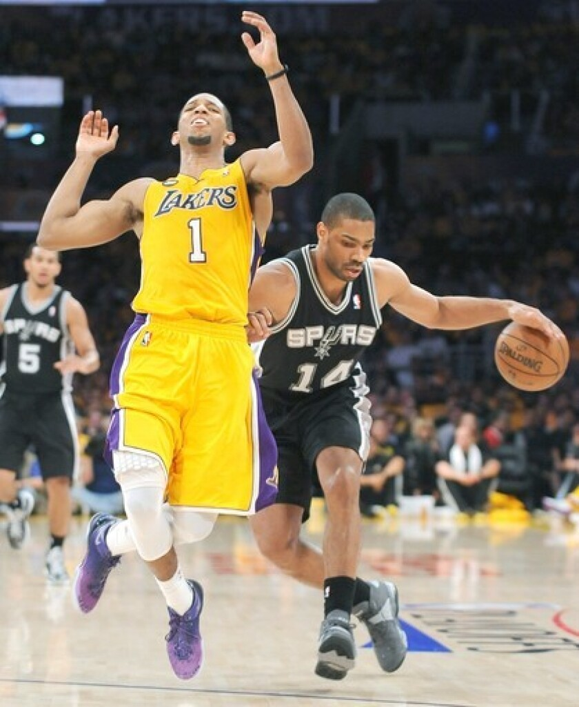 Lakers guard Darius Morris contests a breakaway by Spurs guard Gary Neal in Game 3 of their first-round playoff series on April 26.