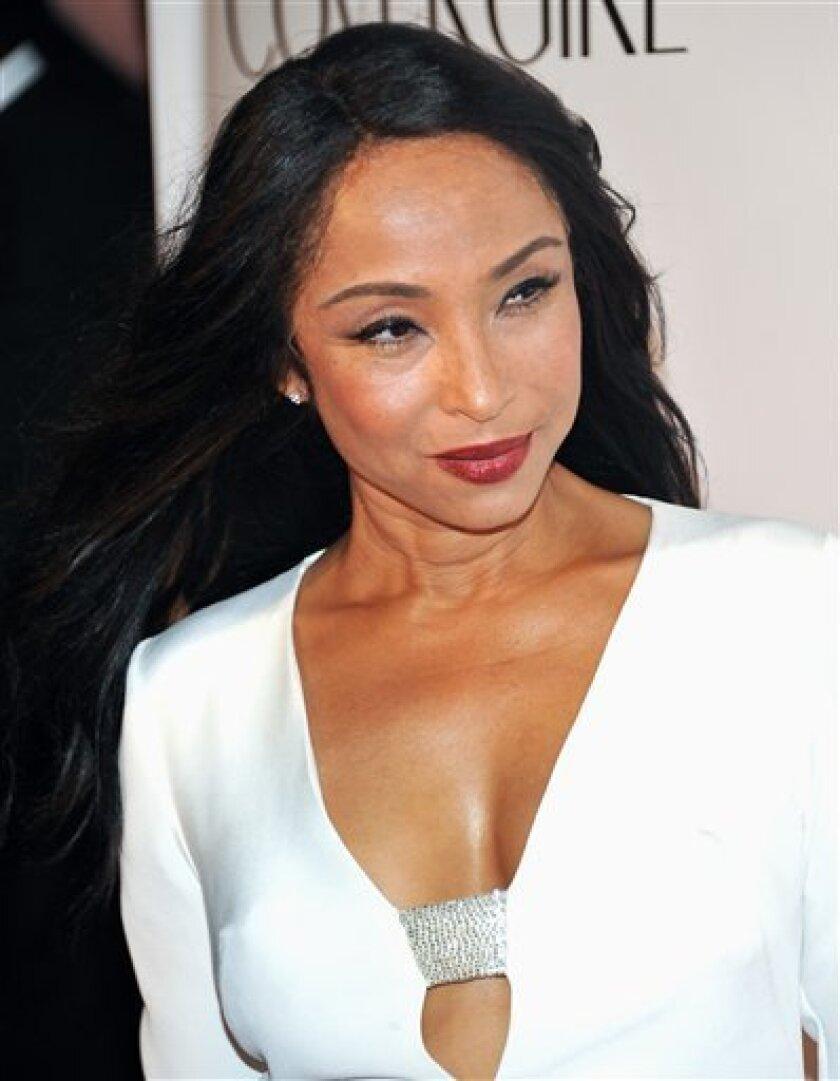 Four Word Reviews: The Best of Sade   PouringBeans